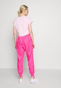 Nike Sportswear - Tracksuit bottoms - hyper pink/pinksicle/white - 2