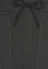 RETHINK Status - JOGGER PLAIN - Tracksuit bottoms - iron - 2
