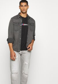 G-Star - ALUM RELAXED TAPERED - Relaxed fit jeans - sato black denim/sun faded ripped pewter grey - 3
