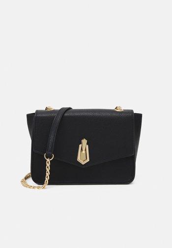 PCADA CROSS BODY - Across body bag - black/gold-coloured