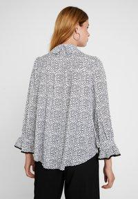 Sister Jane - POLKA RUFFLE BLOUSE - Button-down blouse - black/white - 2