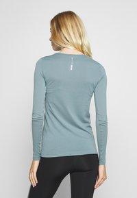 ONLY Play - ONPSTACIA CIRCULAR - T-shirt sportiva - goblin blue - 2