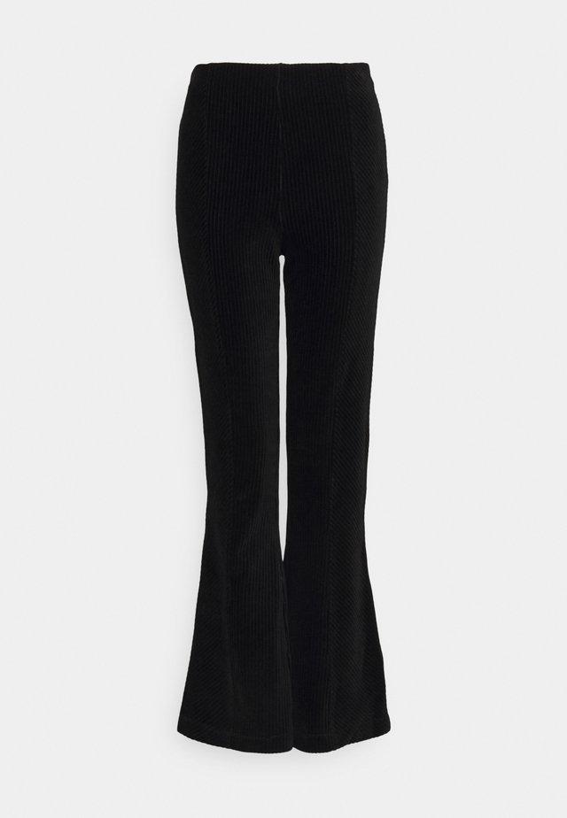 TACITURNE PANTALON - Trousers - black