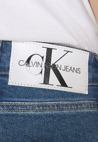Calvin Klein Jeans Plus - MOM - Relaxed fit jeans - denim medium - 4