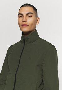 Calvin Klein - CASUAL BLOUSON JACKET - Summer jacket - green - 3