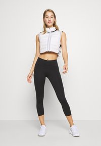 Nike Performance - EPIC CROP - Collant - black/reflective silver - 1