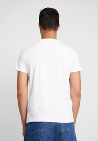 Calvin Klein Jeans - SLIM FIT 2 PACK - Basic T-shirt - bright white/black beauty - 3