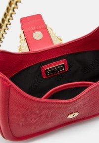 Versace Jeans Couture - BUCKLE SHOULDER BAG - Across body bag - paradise - 7