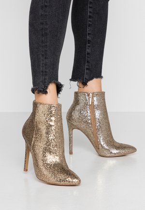High heeled ankle boots - champagne
