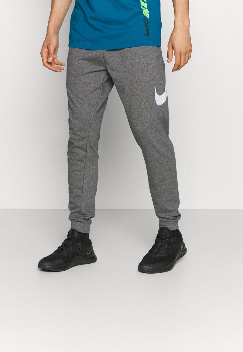 Nike Performance - TAPER - Trainingsbroek - charcoal heather/white