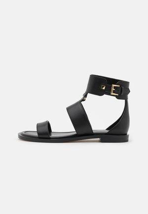 AMOS FLAT  - Ankle cuff sandals - black