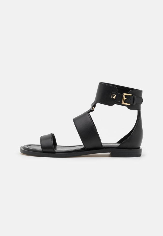 AMOS FLAT  - Ankle cuff sandals - black