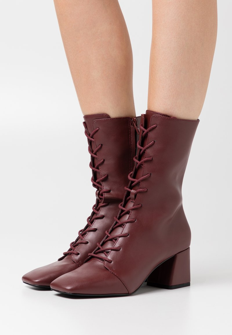 Monki - VEGAN THELMA BOOT - Lace-up boots - whine red