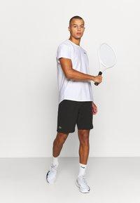 Lacoste Sport - TENNIS SHORT - Sports shorts - noir/blanc - 1
