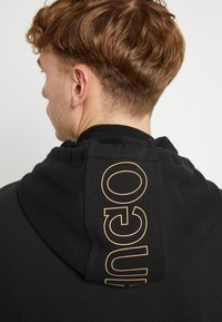 HUGO - DINORO - veste en sweat zippée - black/gold - 6