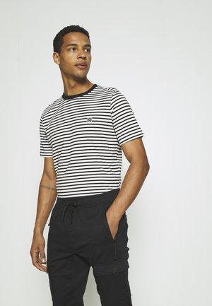 JOGGER - Trousers - black/white
