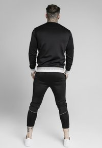 SIKSILK - DELUXE AGILITY JOGGER - Tracksuit bottoms - black - 2