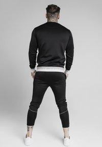 SIKSILK - DELUXE AGILITY JOGGER - Pantalones deportivos - black - 2
