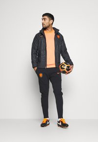 Nike Performance - NIEDERLANDE KNVB  - Veste de survêtement - black/safety orange - 1