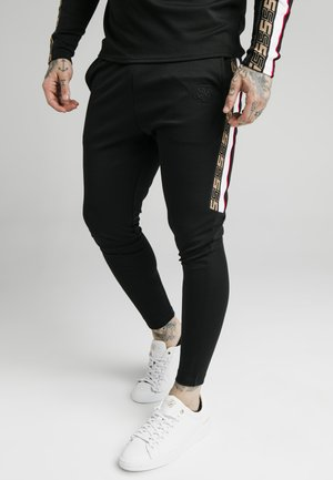 RETRO ATHLETE PANT - Verryttelyhousut - black