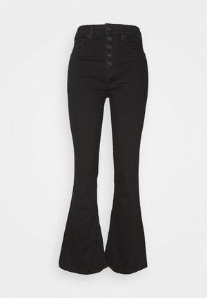 HIGHEST RISE  - Jean flare - bold black