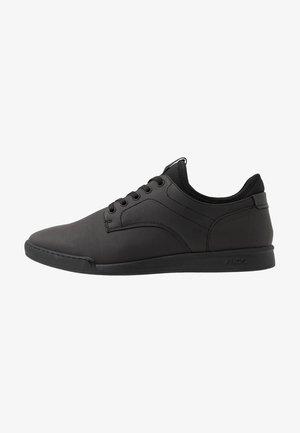 RHISIEN - Trainers - black