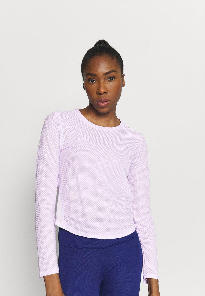 Puma - TRAIN LONG SLEEVE - Maglietta a manica lunga - light lavender