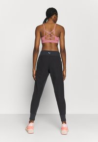 Puma - STUDIO FITTED PANT - Tracksuit bottoms - black - 2