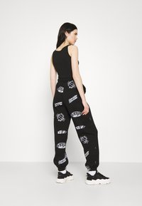 Topshop - VIRTUAL REALITY - Tracksuit bottoms - black - 2