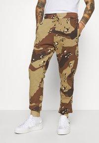 STAPLE PIGEON - UNISEX GARMENT - Pantalon de survêtement - beige - 0