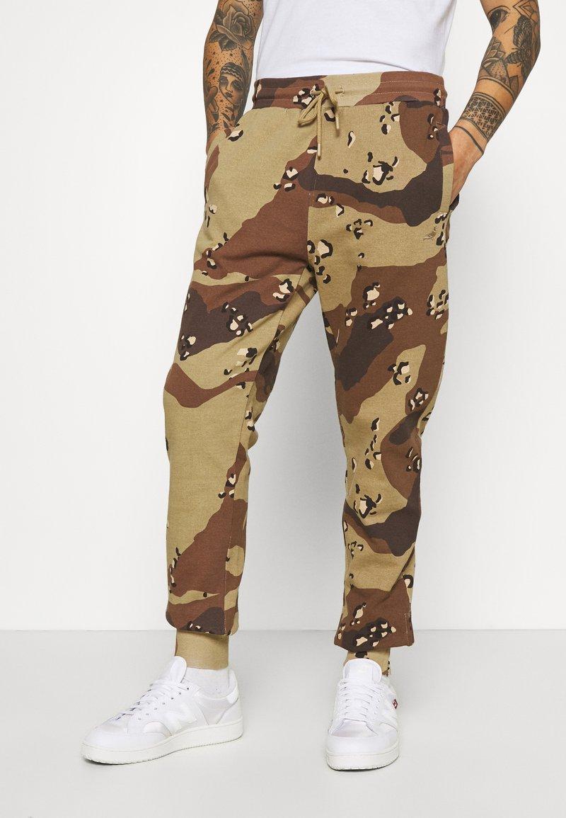 STAPLE PIGEON - UNISEX GARMENT - Pantalon de survêtement - beige