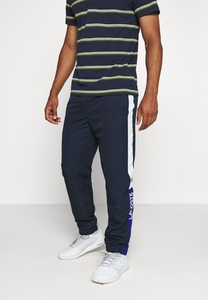 TENNIS PANT - Trainingsbroek - navy blue/wasp-white-cosmic