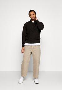 Champion Reverse Weave - HALF ZIP - Sweatshirt - black - 1