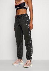 Champion - ELASTIC CUFF PANTS - Tracksuit bottoms - black - 0