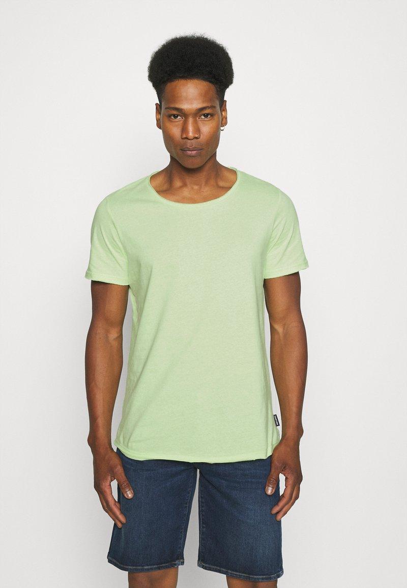 YOURTURN - RAW EDGE UNISEX - Basic T-shirt - green