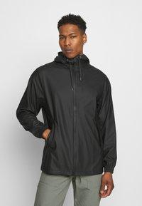 Rains - STORM BREAKER UNISEX - Vodotěsná bunda - black - 0