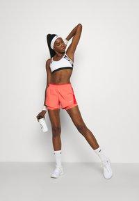 Nike Performance - 10K SHORT - Sports shorts - magic ember/chile red/magic ember/wolf grey - 1