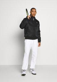 Lacoste Sport - PREMIUMI JACKET - Winter jacket - black - 1