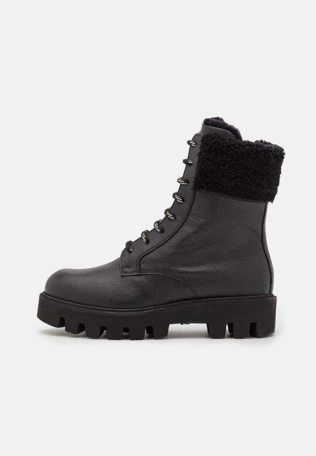 COPENHAGEN  - Lace-up ankle boots - black