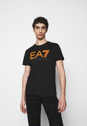 T-shirt con stampa - black/orange