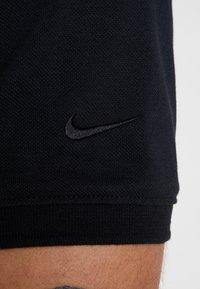 Nike Golf - Funkční triko - black - 5