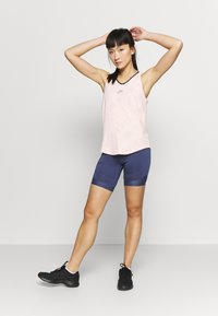 Nike Performance - AIR TANK - Sports shirt - washed coral - 1