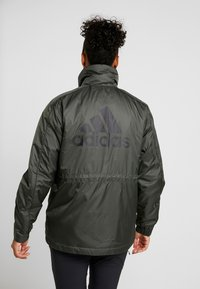 adidas Performance - INSULATED OUTDOOR FILLED THIN JACKET - Kurtka zimowa - legend earth - 2