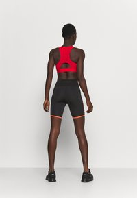 ASICS - FUTURE TOKYO SPRINTER - Tights - performance black/sunrise red - 2
