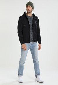 Haglöfs - NATRIX HOOD MEN - Soft shell jacket - true black - 1