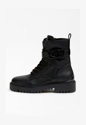 ORANA LOGO SEITLICH - Platform boots - schwarz