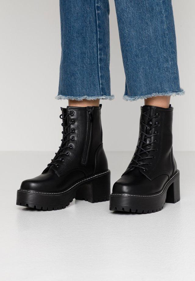 VEGAN DL3 - Platform ankle boots - black