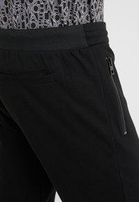 Michael Kors - ZIP JOGGER TRACK PANT - Tracksuit bottoms - black - 5