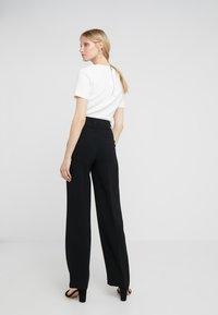 Filippa K - HUTTON TROUSERS - Trousers - black - 2