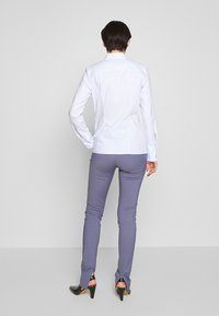 HUGO - THE FITTED - Button-down blouse - light pastel blue - 2